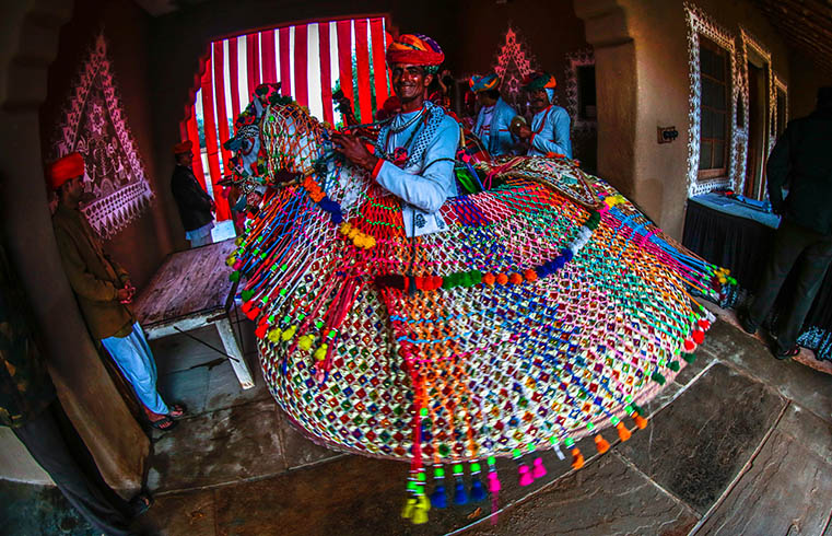 Rajasthani folk artists with props