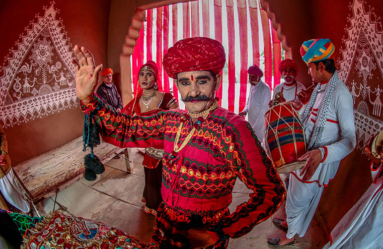 Rajasthani folk dancers flaunting their moves right before their engaging performance.